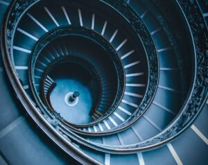 closeup photo of black spiral stairs